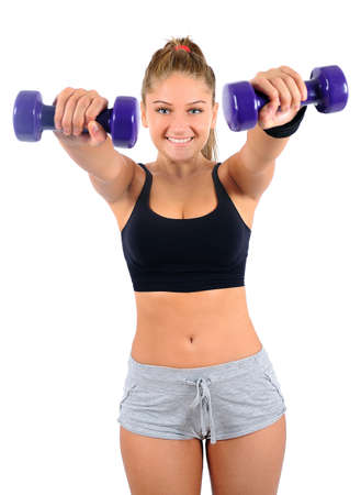 Isolated young fitness woman with dumbbell Stock Photo - 16864527