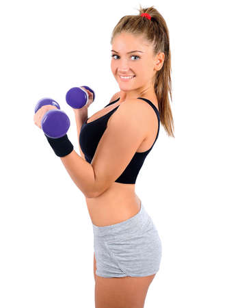 Isolated young fitness woman with dumbbell Stock Photo - 16864127