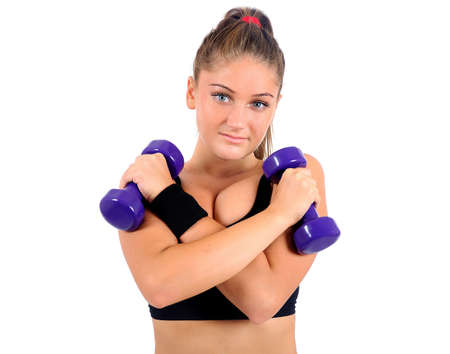 Isolated young fitness woman with dumbbell Stock Photo - 16863874