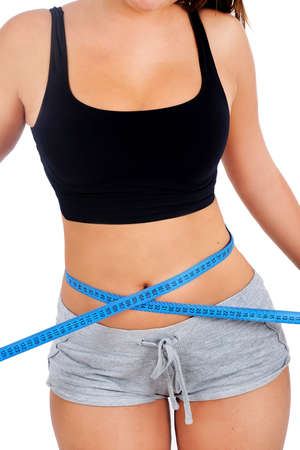 Isolated young fitness woman measure photo