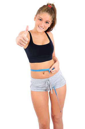 Isolated young fitness woman measure Stock Photo - 16864108