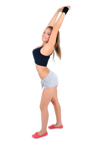 Isolated young fitness woman stretching Stock Photo - 16862198