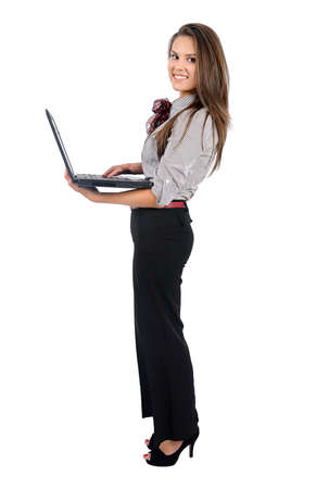 Isolated young business woman with laptop Standard-Bild