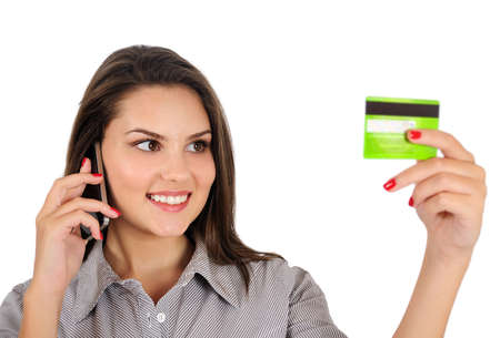 Isolated young business woman with creditcard photo