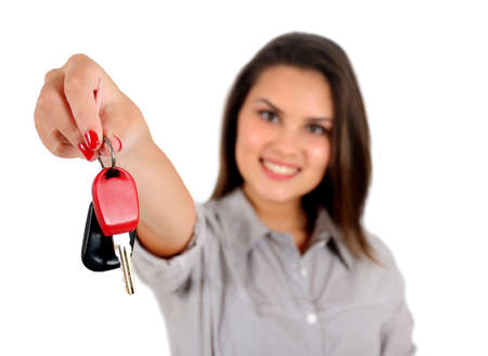 Isolated young business woman showing key photo