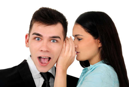 Isolated young business couple whispering photo