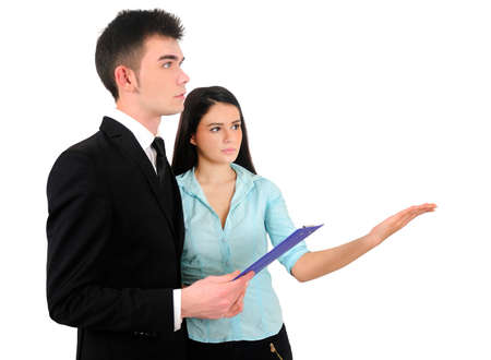 Isolated young business couple showing photo