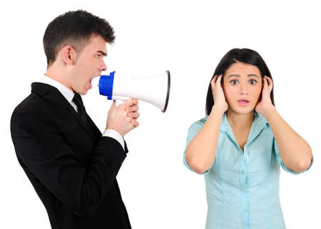 Isolated young business couple with loudspeaker photo