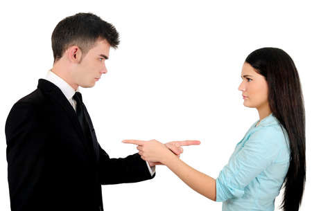 conflict: Isolated young business couple argue Stock Photo