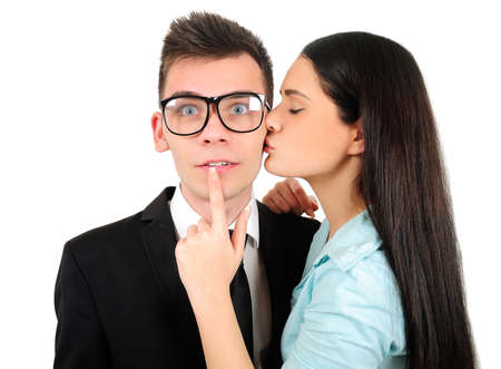 Isolated young business couple kissing photo