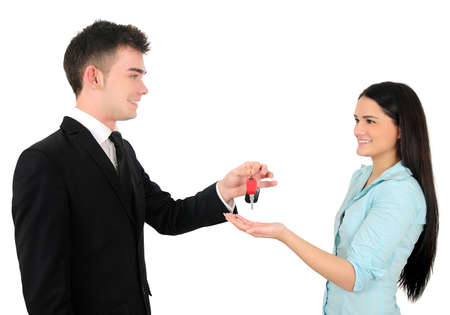 Isolated young business couple with car key photo