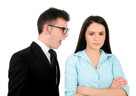 Isolated young business couple argue Foto de archivo