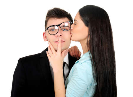 Isolated young business couple kissing Foto de archivo