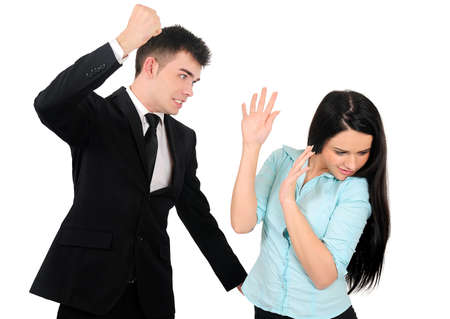 violence in the workplace: Isolated young business couple argue Stock Photo