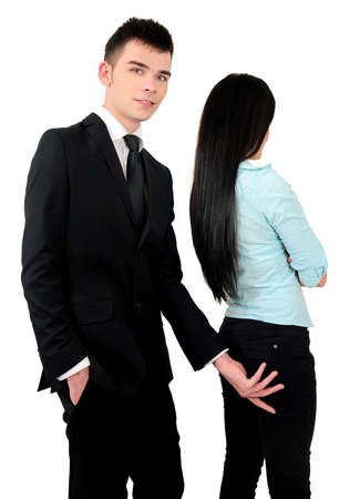 Isolated young business couple harassment photo
