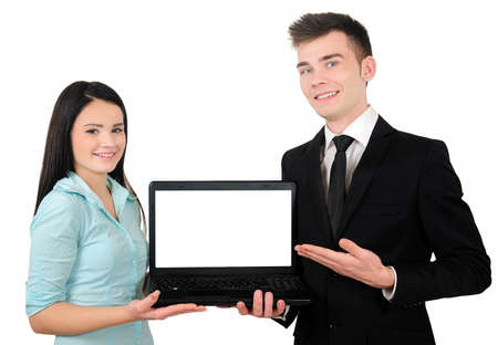Isolated young business couple presenting laptop photo