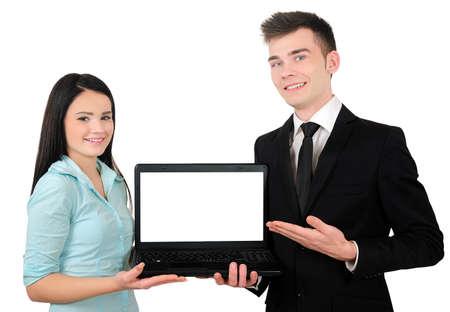 Pareja aislada negocios joven que presenta laptop photo