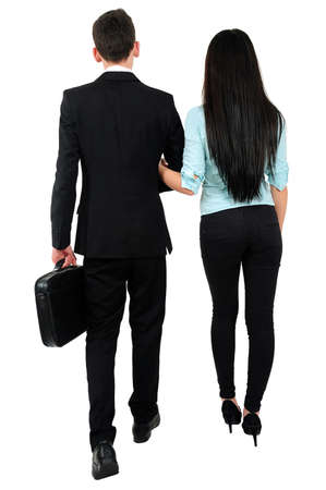 Isolated young business couple walk photo
