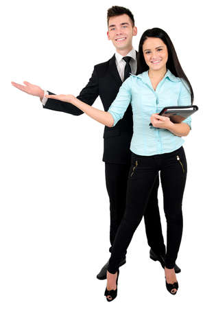 Isolated young business couple presenting photo