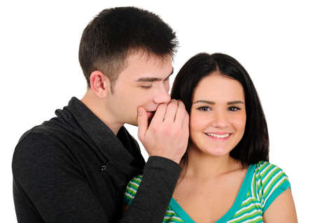 Isolated young casual couple gossip photo