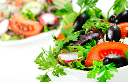 Bowl with salad on white Stock Photo - 18362174