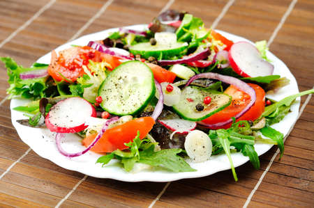 Plate with salad on brown table photo