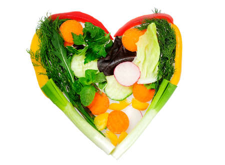 Heart shape made of vegetables photo
