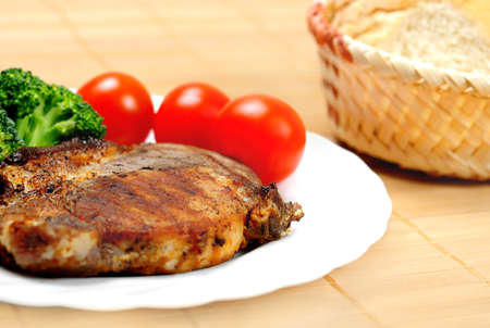 Plate with grilled meat and salad photo