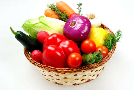 Basket with different raw vegetables photo
