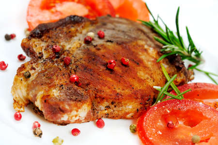 Plate with grilled meat and tomatoes photo