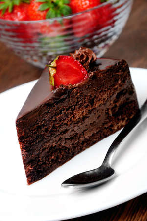 Cake with chocolate and strawberry on table  photo