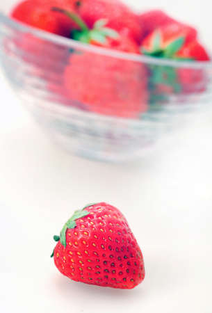 Isolated bowl with strawberry on white background  photo
