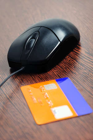 Mouse and card payment  on table  photo