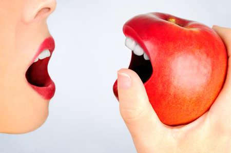 Girl eating apple on blue background  photo