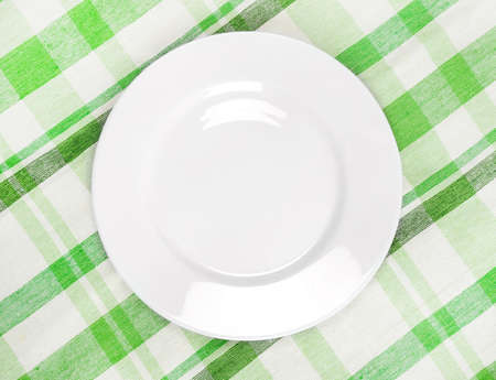 contemporary taste: Empty plate at classic  tablecloth Stock Photo