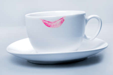 beautiful lips: Lipstick pink on white  cup on blue background  Stock Photo