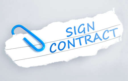 broken contract: Sign contract word on grey background