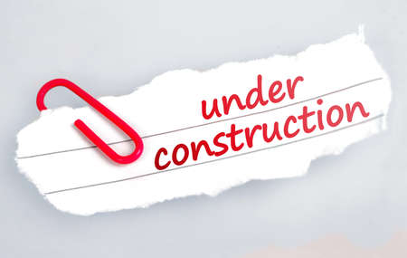 web page under construction: Under construction word on grey background