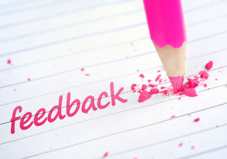 feedback: Feedback word and pink pencil
