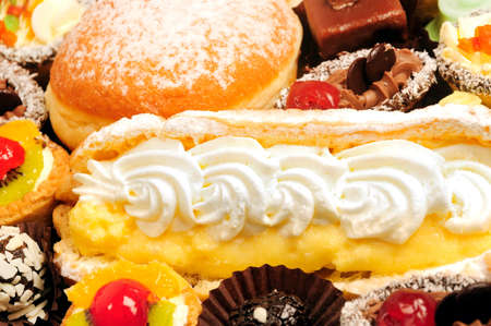 Many cakes,eclaire and donat Stock Photo - 21624327