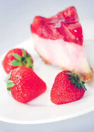 Cake with strawberry on grey background  photo