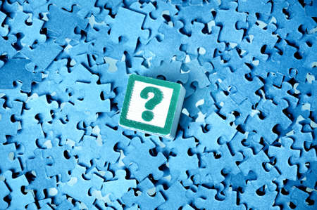 Question  mark on a puzzle  background  photo