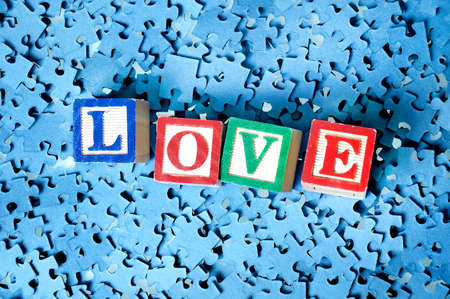 Love word on a puzzle  background  photo