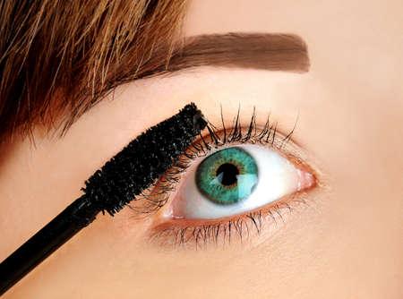 Woman applying mascara on eye Stock Photo - 21624881