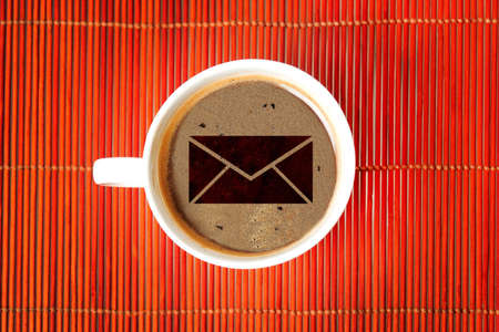 Mail shape on coffee cup photo