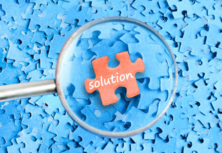 Solution word on puzzle background  photo
