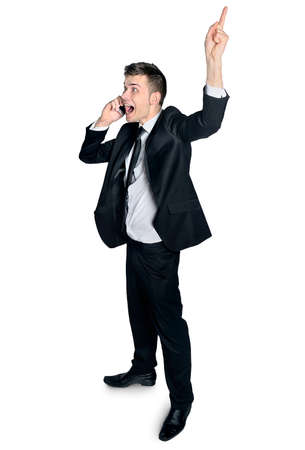 man pointing up: Business man pointing up when phone talking Stock Photo