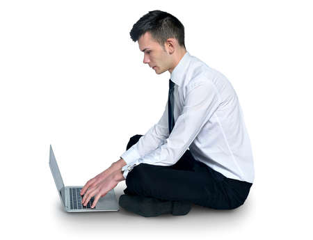 Isolated business man using notebook  photo