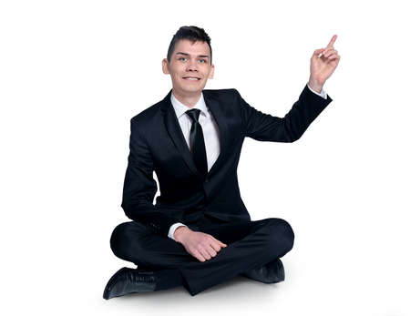 Business man pointing up corner photo