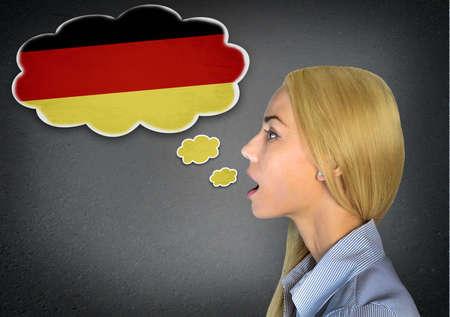 Woman speaking german in bubble Standard-Bild